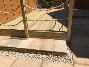 Decking, reclaimed slabs and sandstone