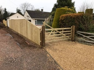 Feature wooden fence and new five bar gar