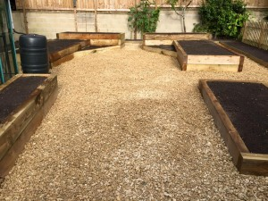 Raised beds with gravel surround ideal for flowers or vegetables